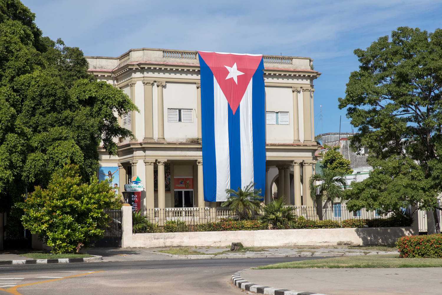 Cuban flag hanging from a building. - Cuba Photography