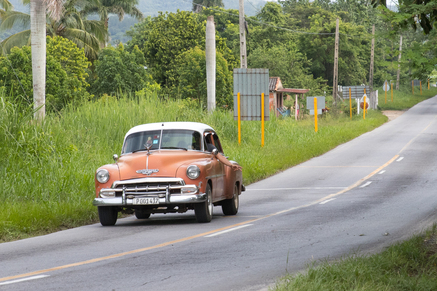 Classic car driving in the Cuban countryside. - Cuba Photography