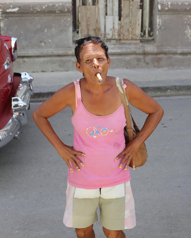 Cuban woman smoking a cigar. - Cuba Photography